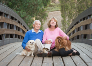 Jans and husband photo with dogs
